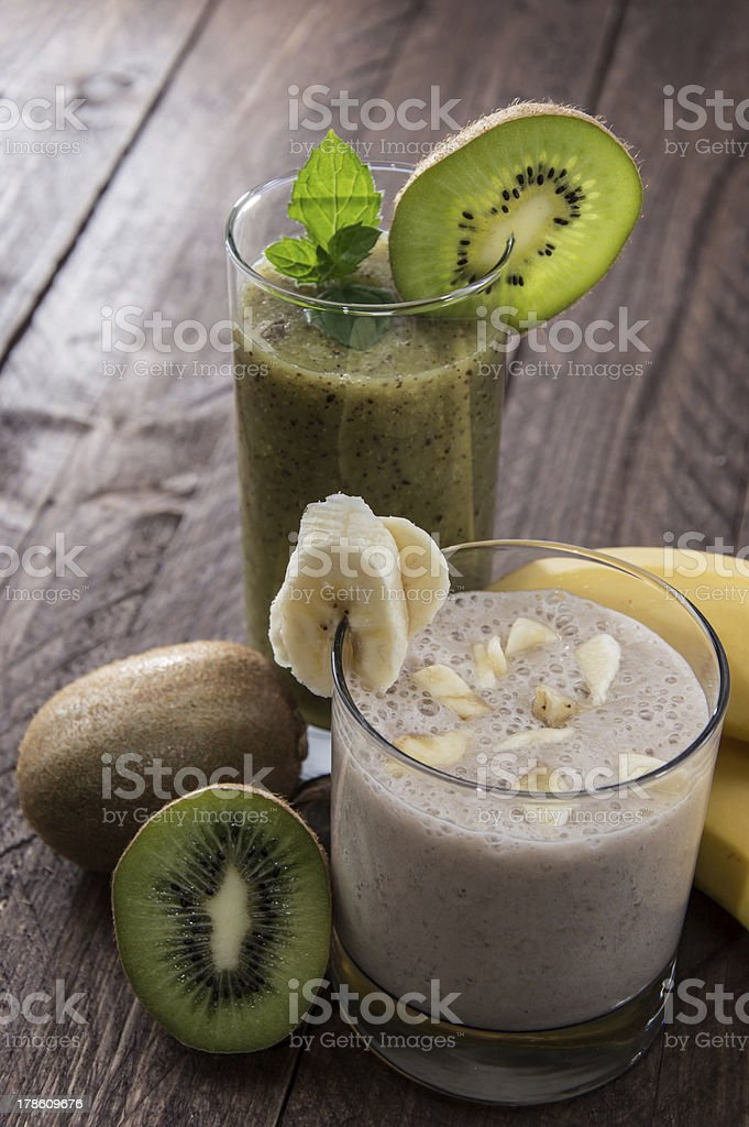 Banana- and Kiwi Smoothie with fresh fruits stock photo