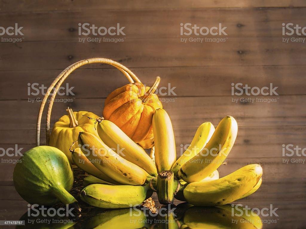 Banana and pumpkins stock photo