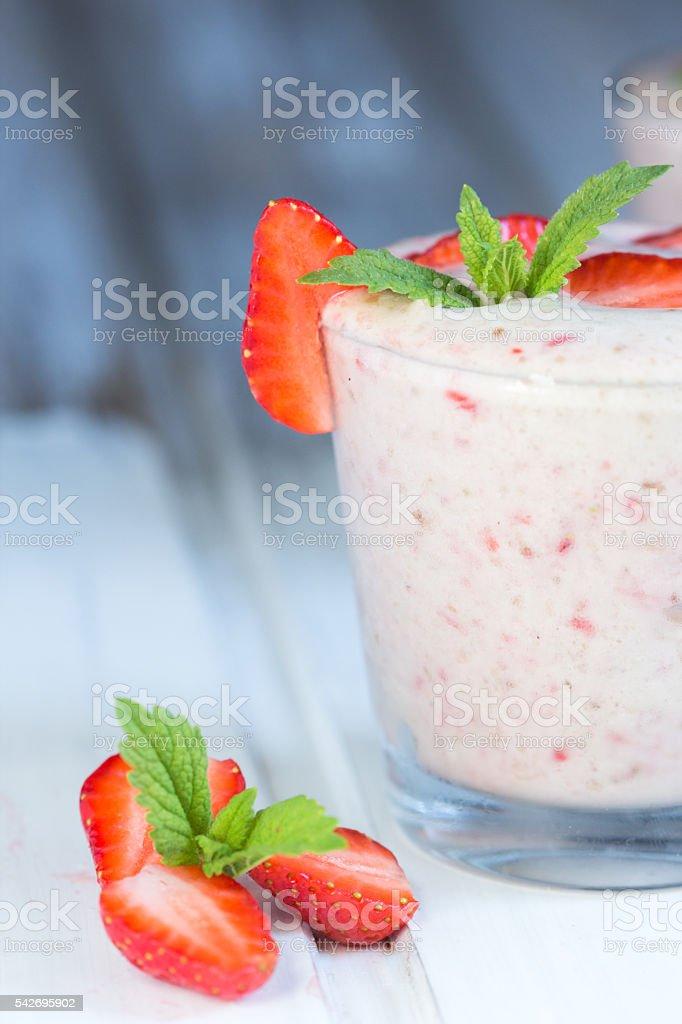Banana and strawberry smoothie on white background royalty-free stock photo