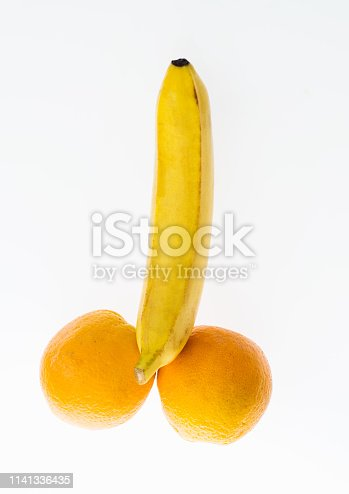 Banana and two oranges isolated on white background.