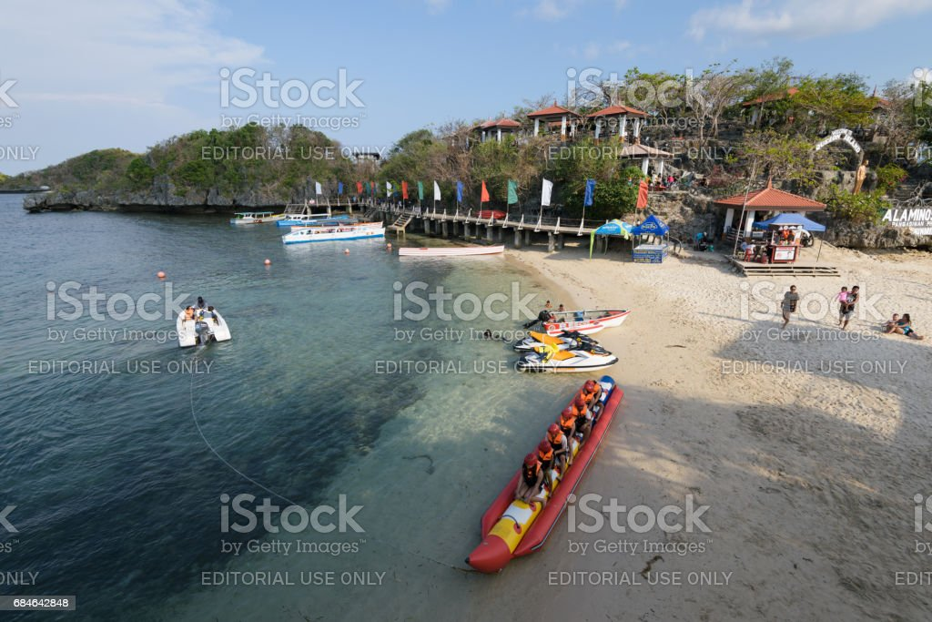 Banana Boat ride in Hundred Islands National Park in the Philippines. stock photo