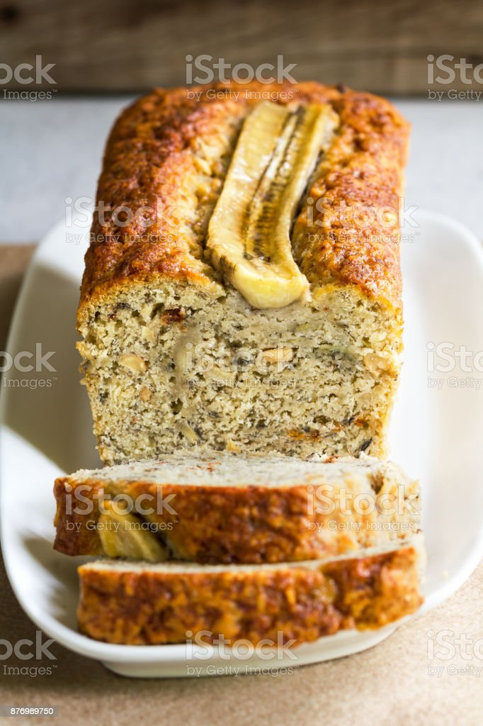 Banana Bread and Nut Loaf with slice of Banana on top stock photo