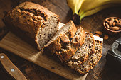 Banana Bread Loaf Sliced On Wooden Table. Wholegrain Banana Cake With Nuts