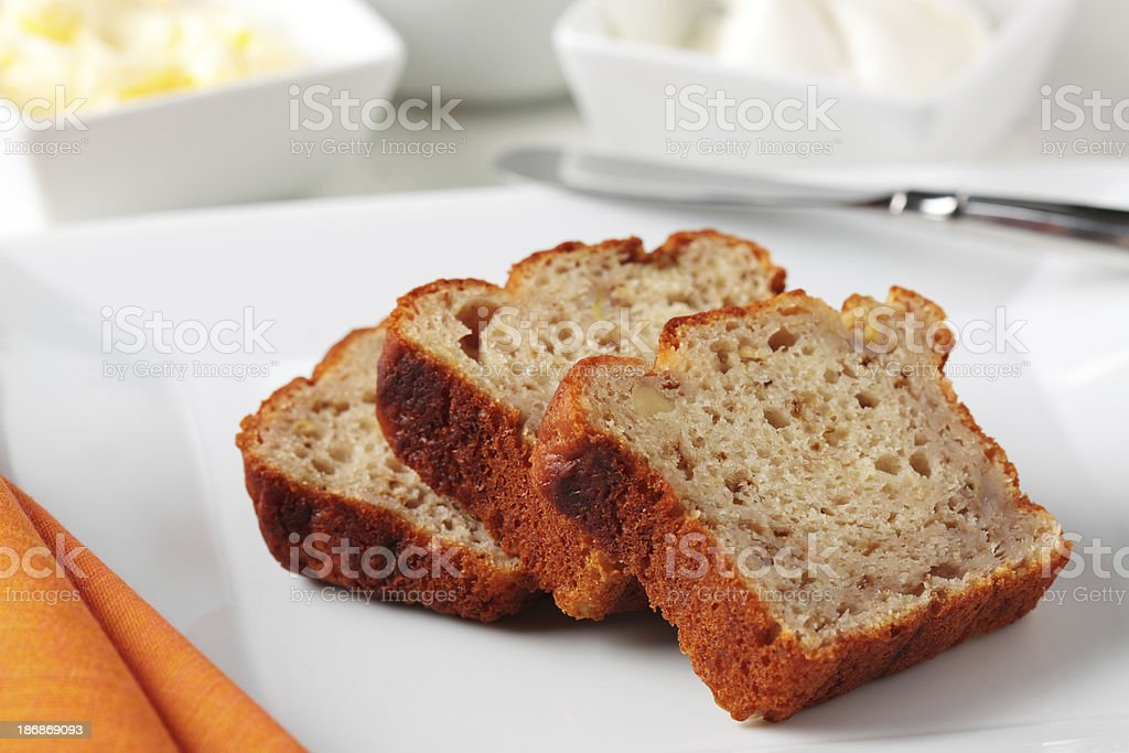 Banana Bread Slice On White Plate stock photo