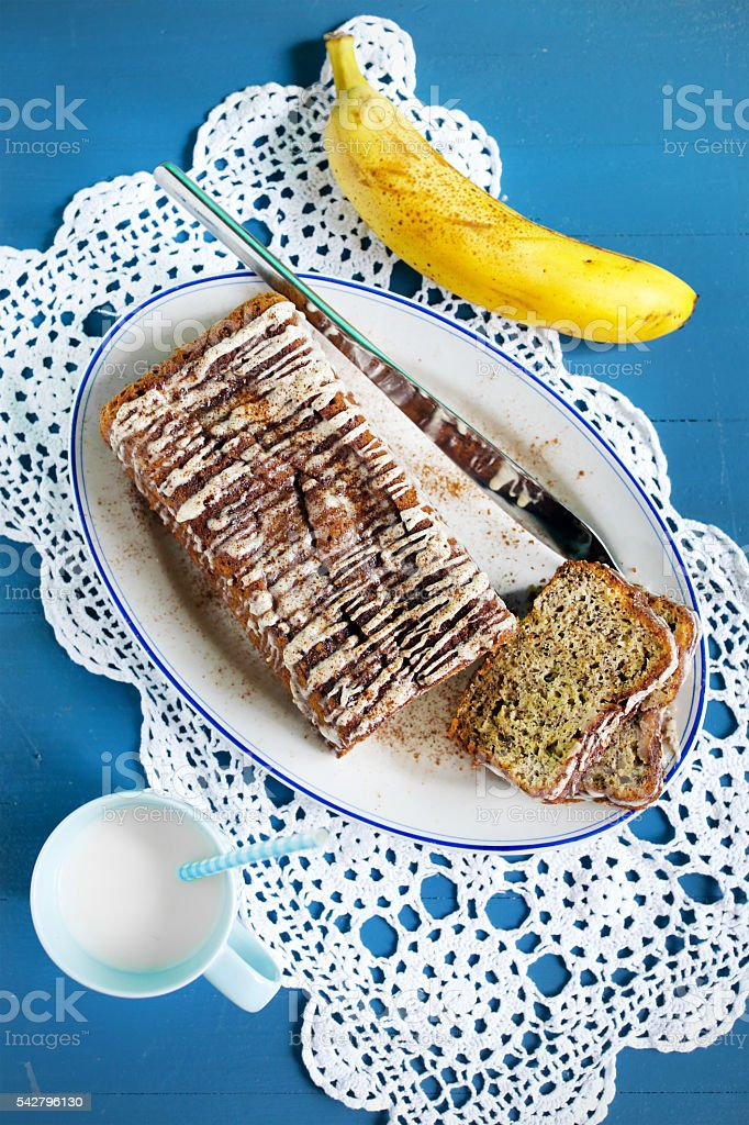 Banana bread with icing and cinnamon with nut milk stock photo