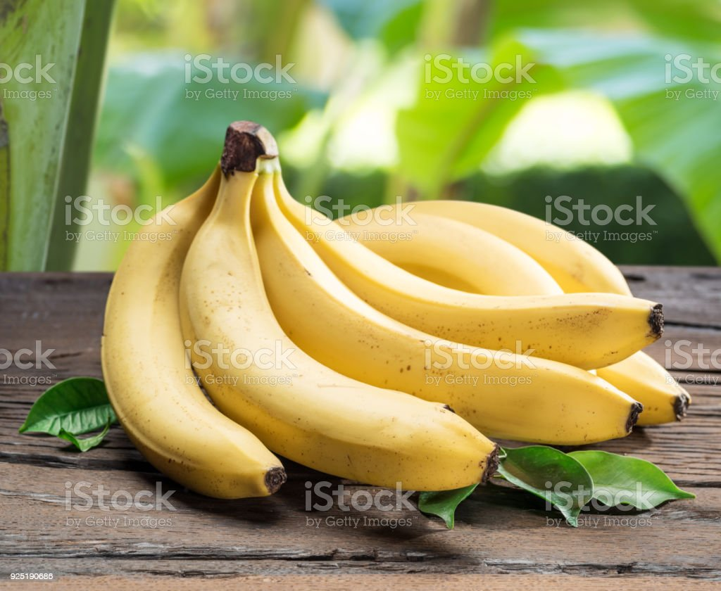 Banana bunch on the wooden table. stock photo