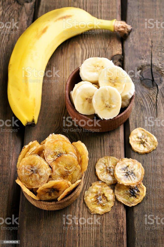 Banana chips and fresh fruits stock photo
