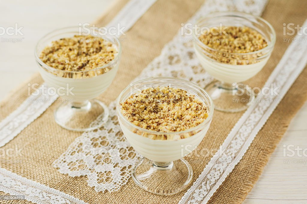 Banana crumble with nuts in rustic style stock photo