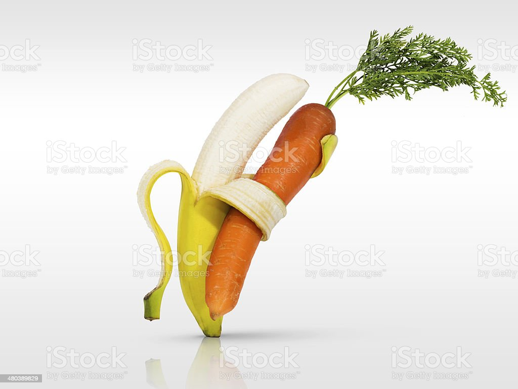 Banana Dancing with carrot fruit and vegetables stock photo