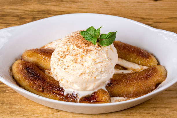 Banana Flambe With Vanilla Ice Cream. close up. Banana Flambe With Vanilla Ice Cream. close up. estudio stock pictures, royalty-free photos & images