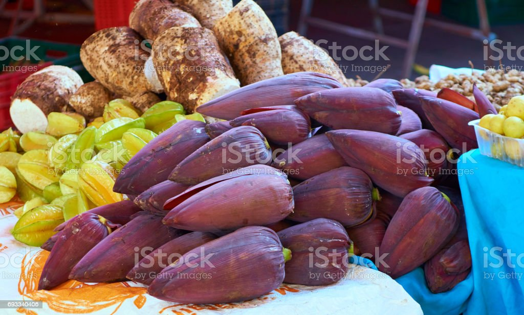 Banana flowers in the market - Reunoin Island stock photo