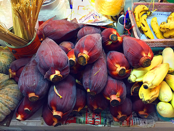 Banana flowers in vegetable market in Thailand stock photo