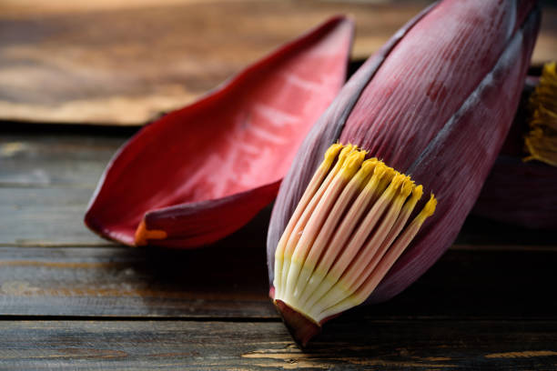 Banana flowers on wooden background stock photo