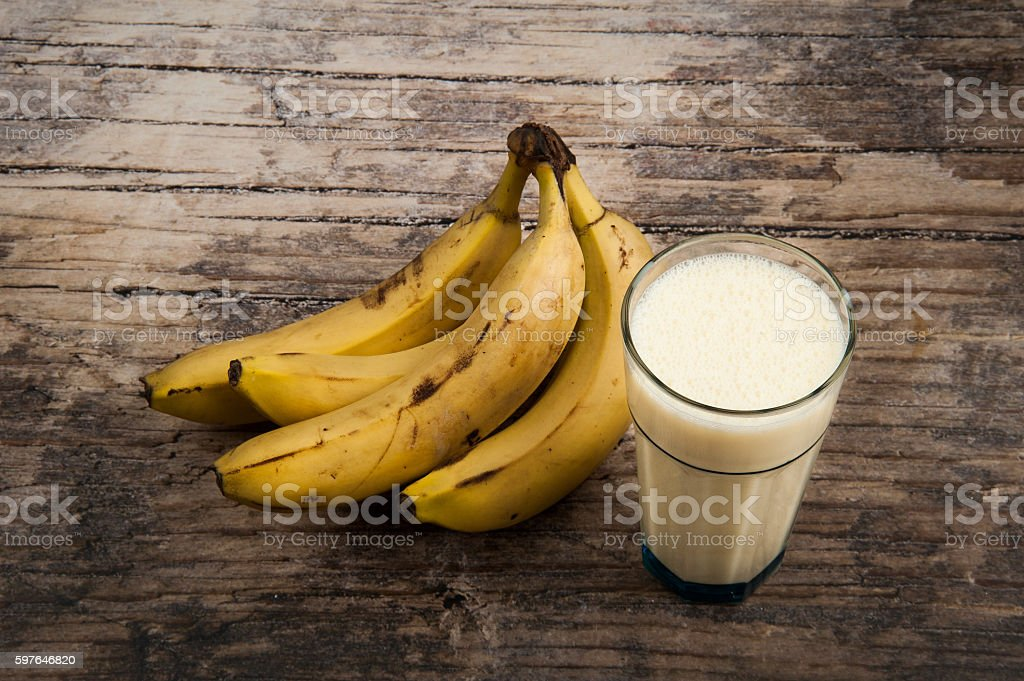 Banana Milkshake on wooden background stock photo