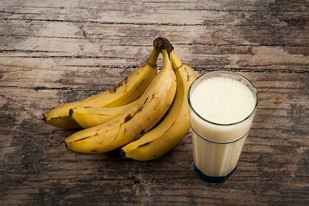 Banana Milkshake on wooden background stock photo