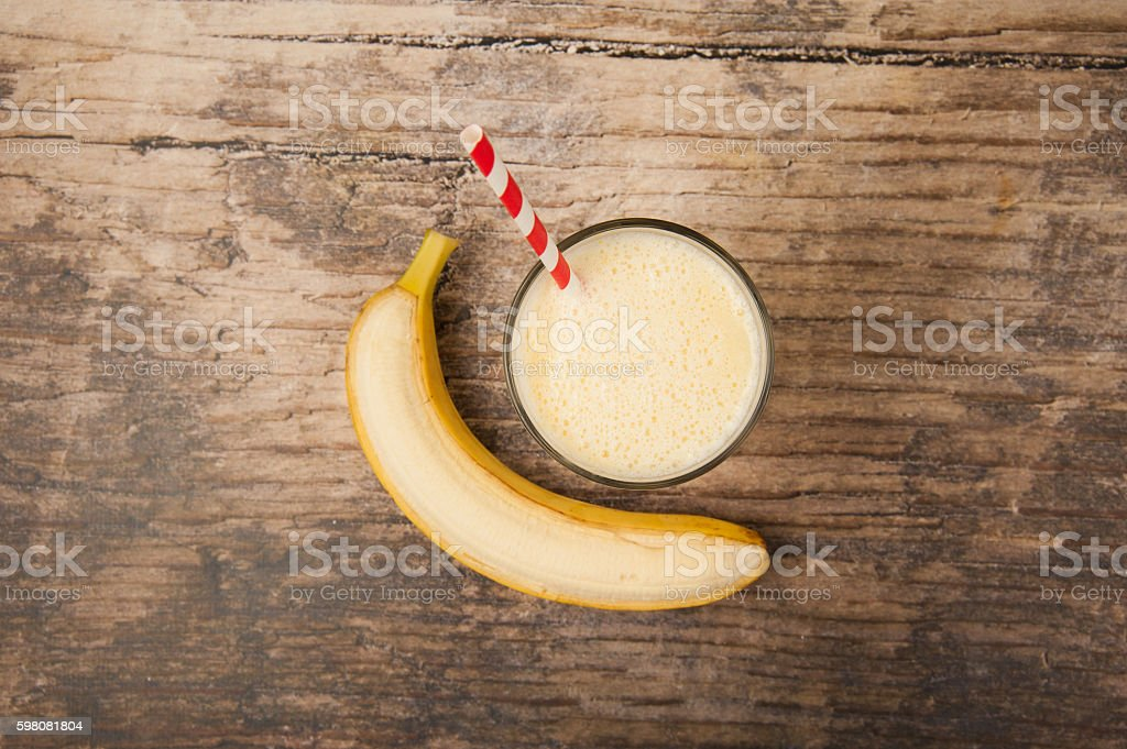 Banana Milkshake on wooden table stock photo