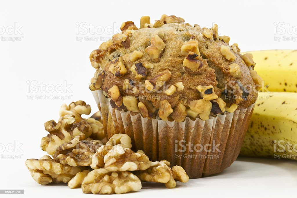 Banana Nut Muffin Surrounded by Bananas and Walnuts stock photo