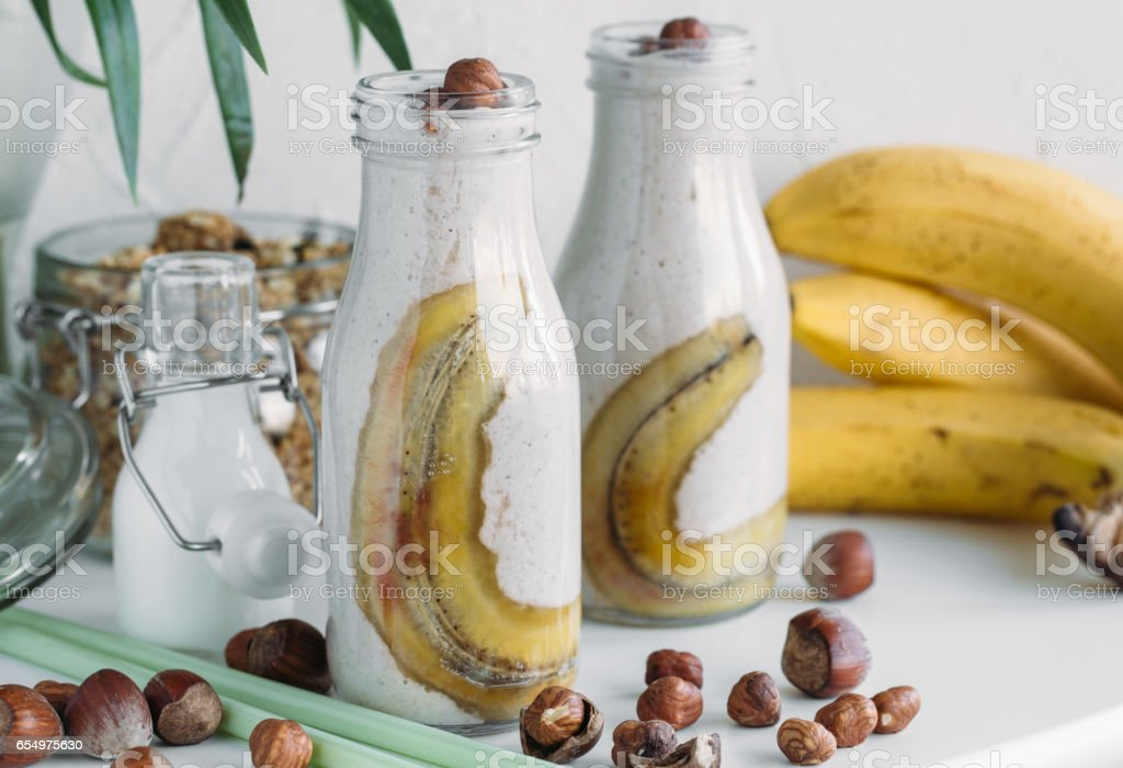 Banana nuts smoothies with caramel. Vegetarian menu concept stock photo