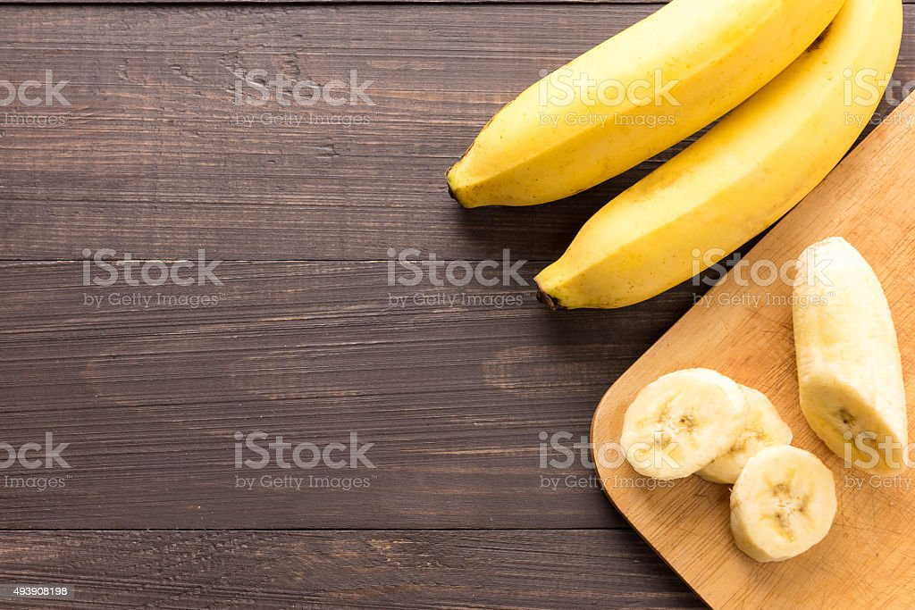 Banana on the wooden background. Top view stock photo