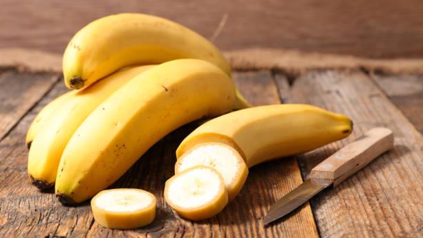 banana on wood background banana on wood background banana stock pictures, royalty-free photos & images