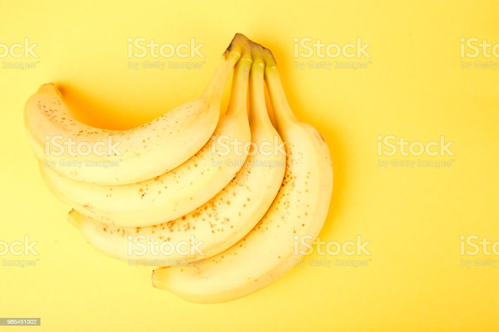 Banana on yellow paper background. zbiór zdjęć royalty-free