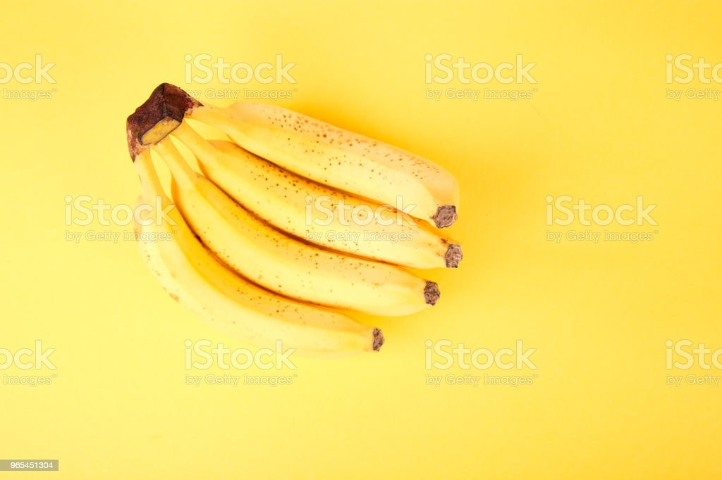 Banana on yellow paper background. royalty-free stock photo