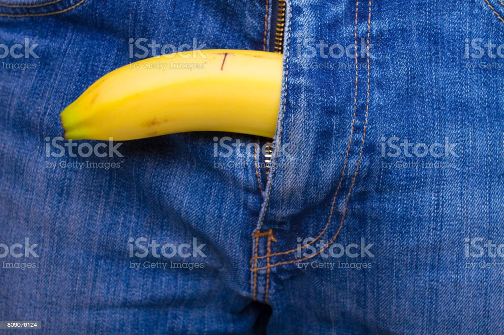 banana out of mens jeans stock photo