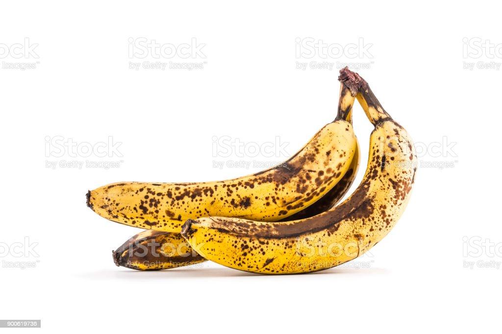 Banane. Über reife Bananen, isoliert auf weiss mit Schatten – Foto