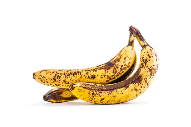 Banana. Over ripe bananas isolated on white with shadows Banana. Over ripe bananas isolated on white with shadows. rotting stock pictures, royalty-free photos & images