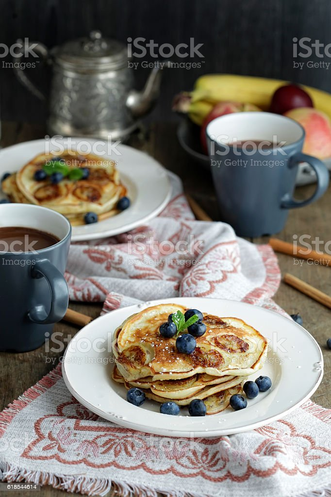 Banana pancakes with blueberry stock photo