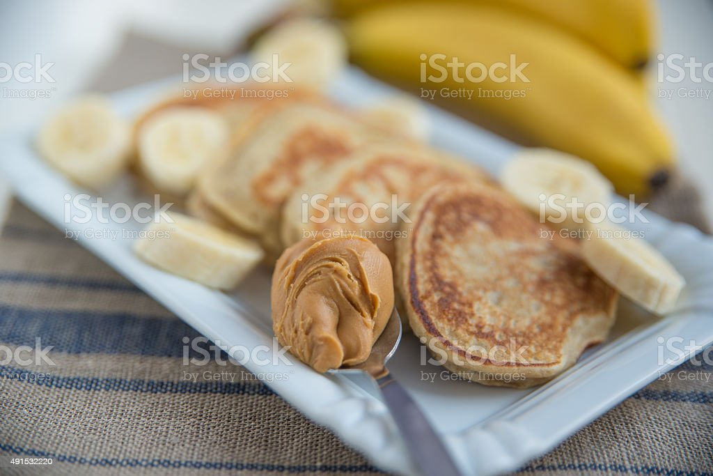 Banana Pancakes with peanut butter stock photo