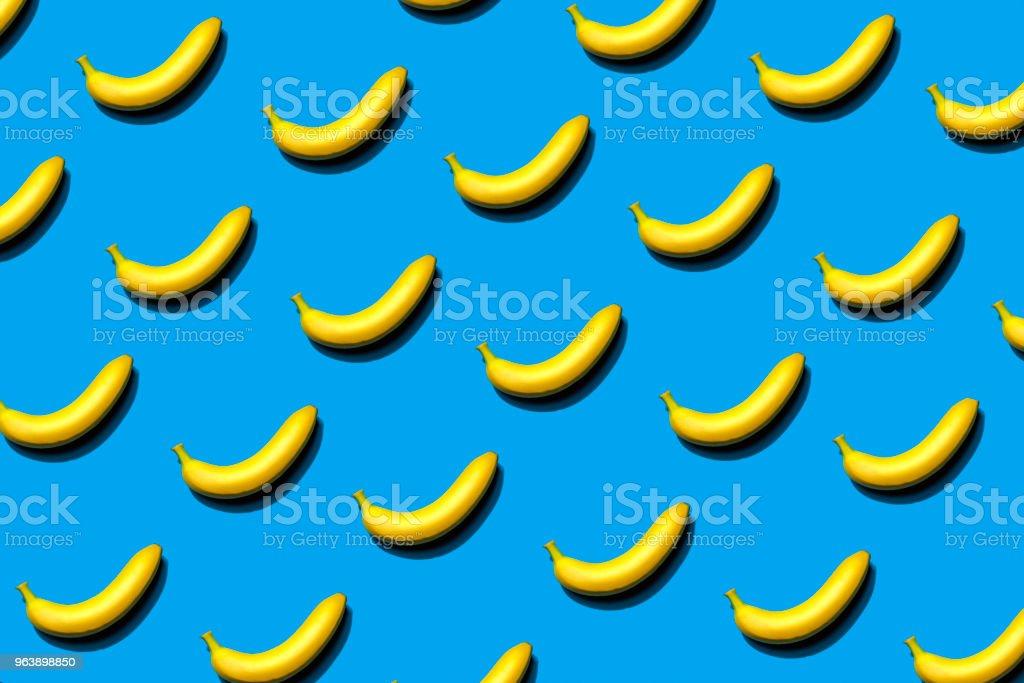 Banana Patter on a Blue Background - Royalty-free Banana Stock Photo