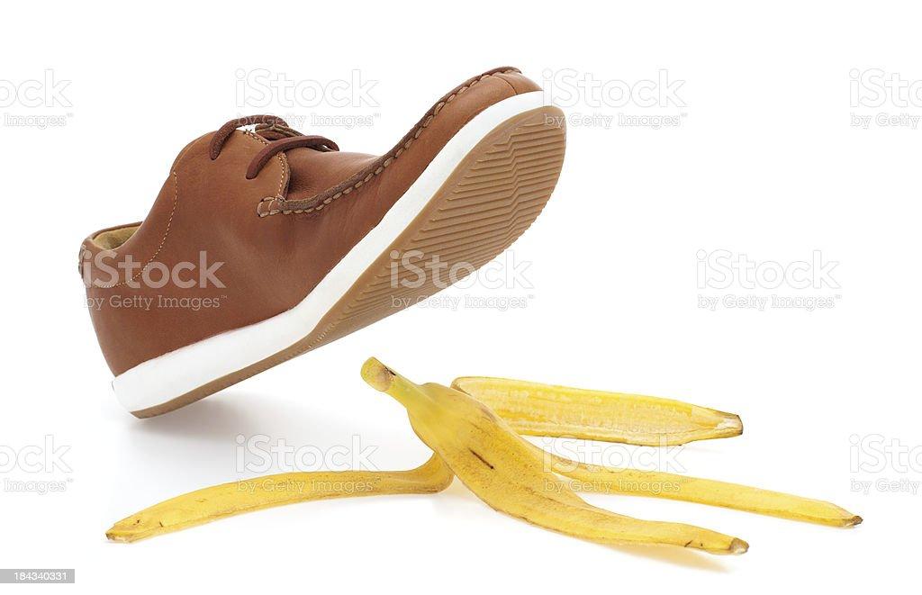 Banana peel and shoe stock photo