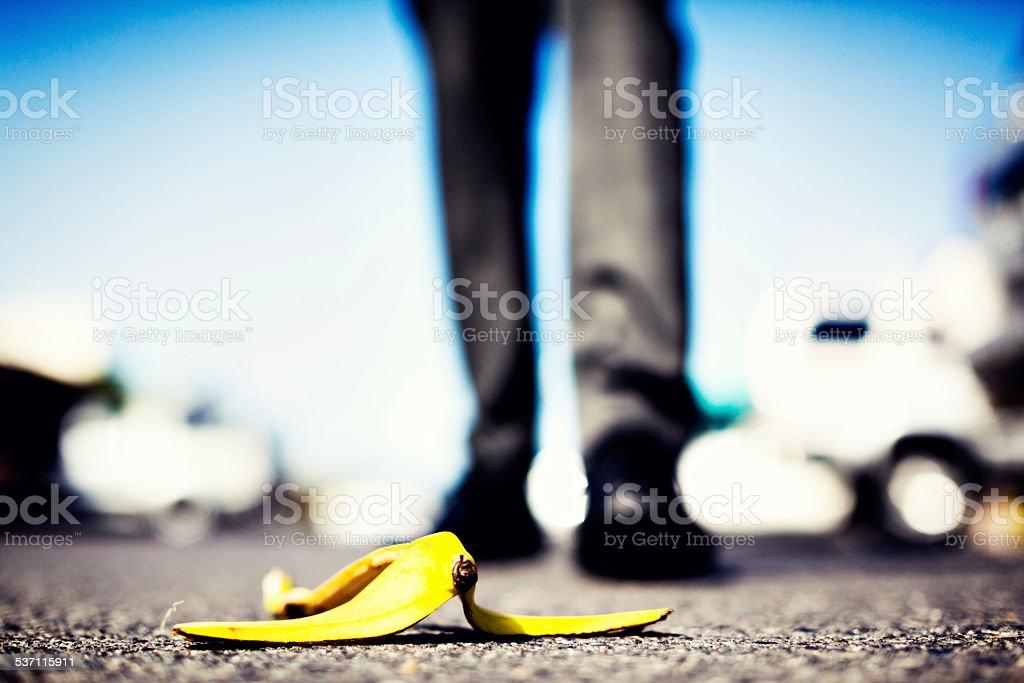 Banana peel lying in wait for unwary pedestrian stock photo