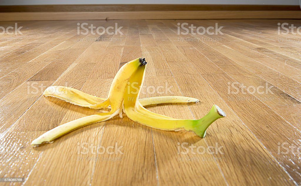 Banana Peel on Parquet Floor – Foto