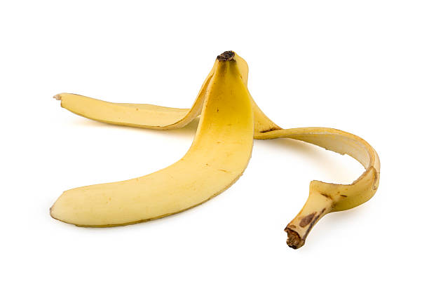 Banana Peel A banana peel isolated on white banana peel stock pictures, royalty-free photos & images