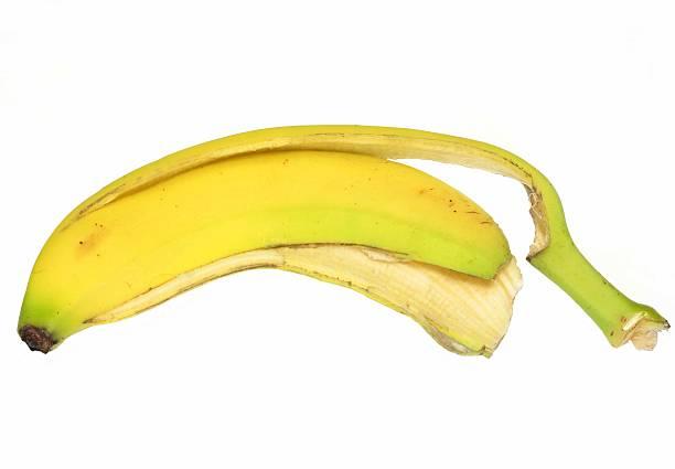 Banana peel Closeup of banana peel on white background banana peel stock pictures, royalty-free photos & images