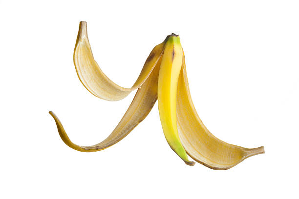 Banana peel Banana peel floating on air against a white Background banana peel stock pictures, royalty-free photos & images