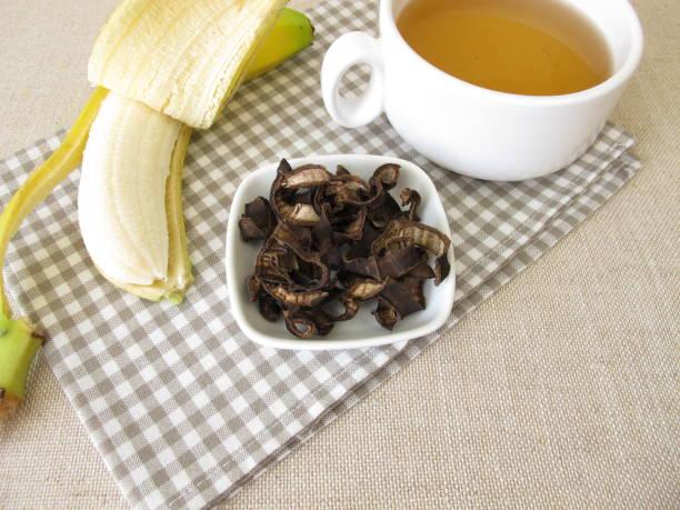 Banana peel tea, a cup of tea from dried organic bananas peels stock photo