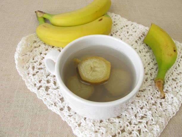 Banana peel tea, tea from organic bananas and banana peel stock photo