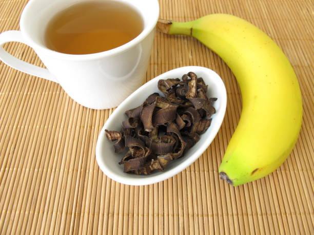Banana peel tea, tea from organic bananas peels stock photo