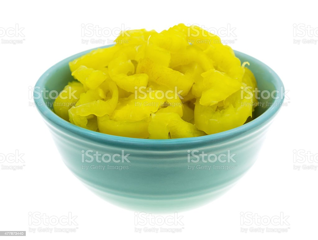 Banana peppers in a bowl on a white background stock photo