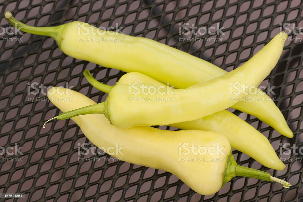 banana peppers on wrought iron table top stock photo