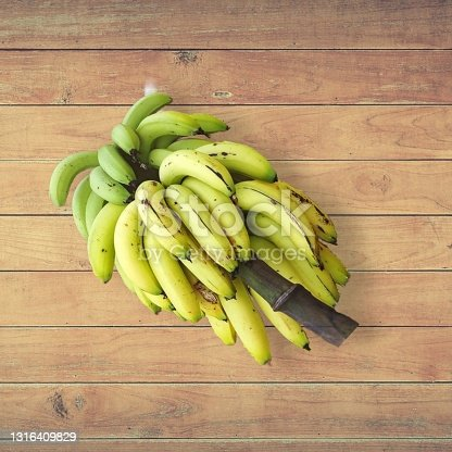 Banana fruits isolated on wooden table selective focus Background