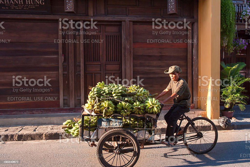 Banana seller drives his cart on the street stock photo