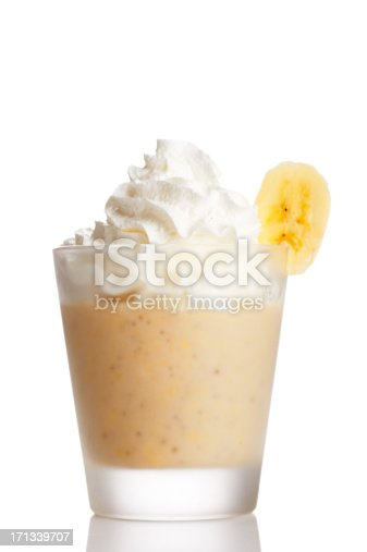 Shake made of banana with wipped cream. Isolated on white.