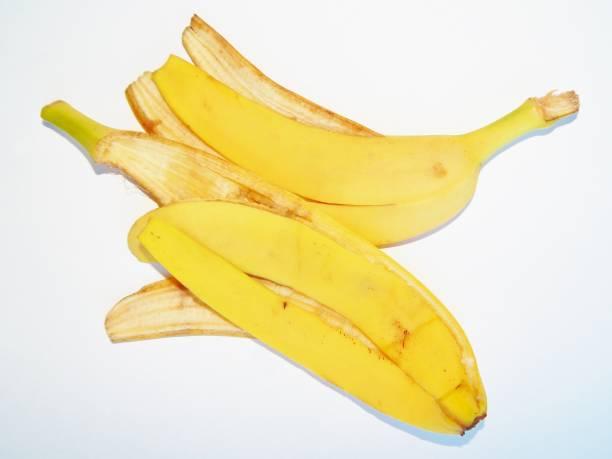 banana skin on a white background banana skin on a white background banana peel stock pictures, royalty-free photos & images