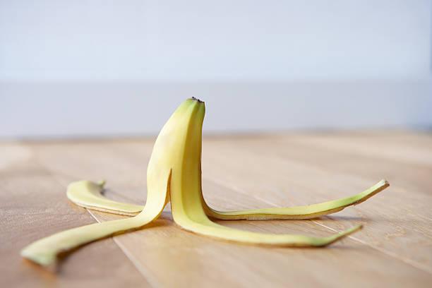 Banana skin on floor Banana skin on floor spilt open at home banana peel stock pictures, royalty-free photos & images