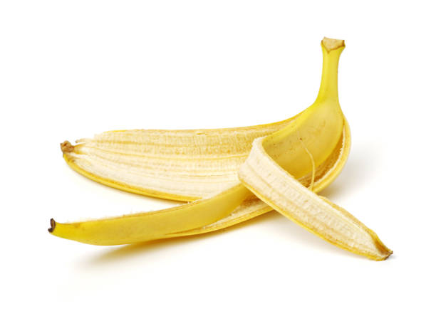 Banana Skin on white background Banana Skin on white background banana peel stock pictures, royalty-free photos & images