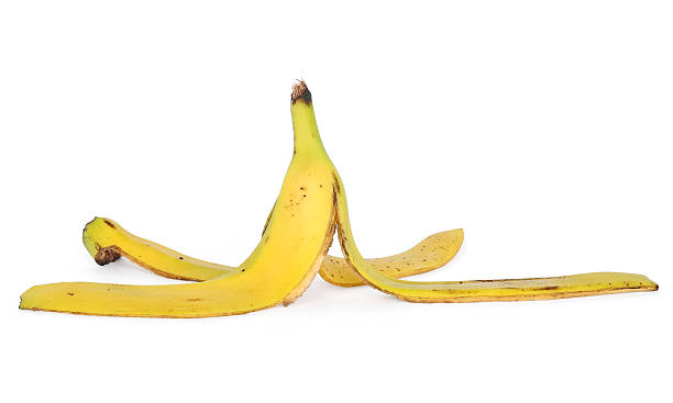 banana skin banana skin isolated on white with clipping path banana peel stock pictures, royalty-free photos & images